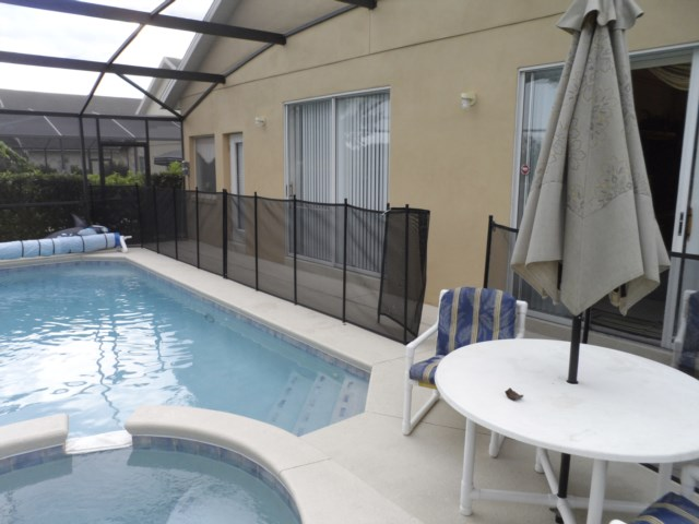 Pool with safety fence erected